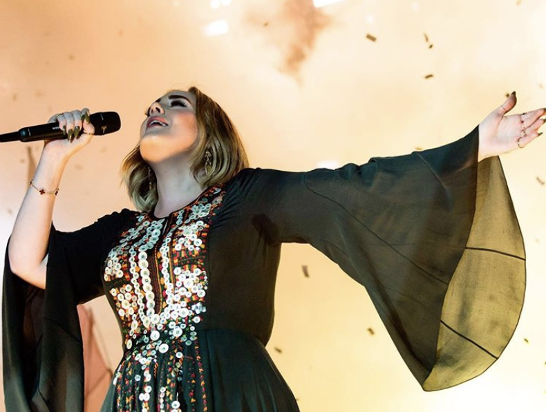 Adele flaunts weight loss as she dons iconic Glastonbury dress